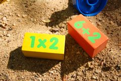 Children`s colored cubes in the sandbox.  Stock Images