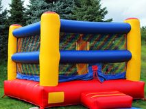 Children`s Colorful Bounce House. Colorful square children`s bounce house with reds, blues, and yellows stock photos