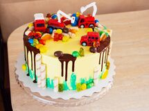 Children`s colorful fondant birthday cake decorated with little cars
