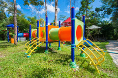 Children`s colorful playground in the park Stock Images