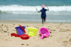 Children's colorful sandy toys on beautiful a beach. India Goa.  royalty free stock photography