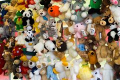 Children`s colorful soft toys hanging on strings at a market.  Royalty Free Stock Image