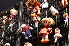 Children`s colorful soft toys hanging on strings at a market stall.  Royalty Free Stock Images