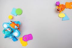 Children`s colorful toys on a gray background with space for text. Flat lay, top view royalty free stock images