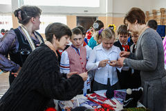 Children's competition of national creativity in the Kaluga region in Russia. In Russia, widespread arts and crafts, including distinctive embroidery, crochet Stock Images