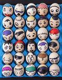 Children's craft of faces drawn on eggs Royalty Free Stock Image