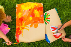 Children's creativity. Children drawing. A picture on the grass stock images