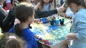 Children`s Creativity. Children Draw Together. Children`s creativity. Children draw together on a large sheet of paper stock video footage