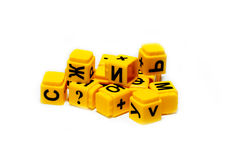 Children's cubes with letters. Children's educational yellow cubes with letters Stock Photo