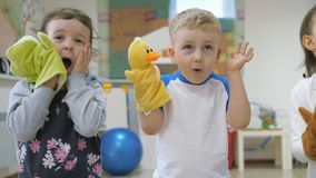 Children`s developing a game room. Emotions of young children during entertaining classes. Kids will have fun playing