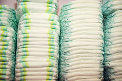 Children's diapers stacked in a many piles Royalty Free Stock Images
