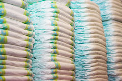 Children's diapers stacked in a piles Royalty Free Stock Photography