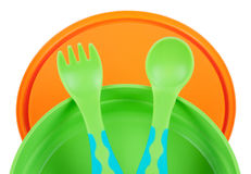 Children's dishes. Children's Plastic tableware isolated on a white background Stock Photography