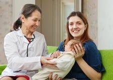 Children's doctor examining newborn baby Stock Image