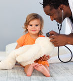 Children's doctor exams a baby with stethos Royalty Free Stock Images