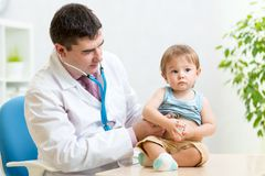 Children's doctor exams infant child with Royalty Free Stock Images