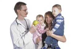 The children's doctor and the small child Royalty Free Stock Image