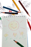 Children's drawing. Notepad, colour pencils, staple, children's drawing Royalty Free Stock Photo