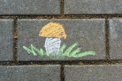 Children`s drawing with chalk on asphalt. royalty free illustration