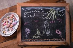 Children`s drawing chalk on a blackboard stock photo