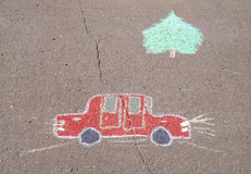 Children's drawing with chalk of car Stock Photos