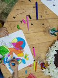 Children s drawing. Children`s drawing and pencils on the table. Artistic, kindergarden Stock Photos