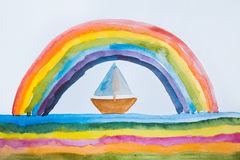 Children`s drawing depicting a beautiful rainbow and boat. Stock Photos