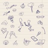 The children`s drawing is drawn on a sheet of school notebook. Children`s drawings of the icon. Happy Valentine`s day. Funny drawings drawn with a pen Stock Photo