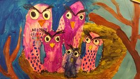 Children`s drawing family of owls. Ukraine. Kiev. Children`s drawing a family of owls sitting on the branches. Funny owls are sitting in the nest royalty free illustration