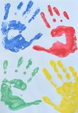 Children`s drawing: multi colored prints of children hands. Friendship concept.  stock images