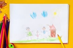 Children`s drawing is my happy family. The concept of child psychology. Children`s drawing is my happy family. The concept of child psychology stock photo