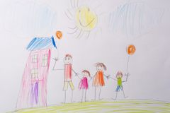 Children`s drawing My Happy Family . The concept of child psychology. stock photo