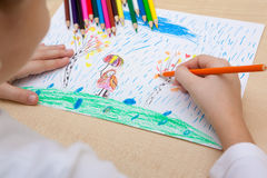 Children`s drawing pencils. The child draws a pencil drawing of the peace Royalty Free Stock Photos