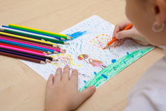 Children`s drawing pencils. The child draws a pencil drawing of the peace. Autumn weather Stock Image