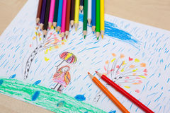 Children`s drawing pencils. Children pencil drawing. Girl with an umbrella in the rain and the tree. Themes of nature protection and peace Stock Image