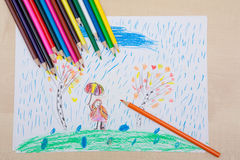 Children`s drawing pencils. Children pencil drawing. Girl with an umbrella in the rain and the tree. Themes of nature protection and peace. Autumn weather Stock Photography