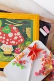 Children's drawing plasticine mushroom amanita autumn still life on a table board crayons candy lollipop Stock Photos