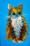 The children`s drawing shows a cat. Blue sheet of paper brown orange white gouache. horizontal