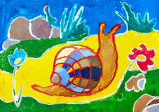 Children`s drawing. Snail crawling on yellow carpet. Children`s drawing. Snail with multicolored shell crawling on yellow carpet Stock Photo