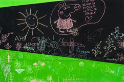 Children`s chalk drawings. Children`s drawings chalk on a blackboard in the inclusive gaming park of the city stock photo