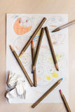 Children's drawings and pencils on the table. stock image