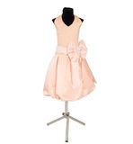 Childrens dress on a dummy. On a white background Stock Photo