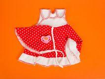 Children's dress, kerchief and pacifier Stock Photography