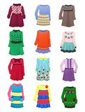 Children's dresses. Set of warm children's dresses with long sleeves isolated on a white background Stock Photo