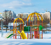 Playground in winter. Children's entertainment during the winter slide Royalty Free Stock Photography