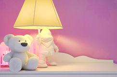 Children's fairy tale for the night. Children's toys, the lamp are located on a table Stock Images