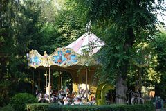 Children`s fantasy. Joy Park. Carousel with horses. stock photos