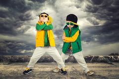 Two brothers dancing break dance.Hip-hop style.The cool kids.Children`s fashion. Children`s fashion.Two brothers dancing break dance.Hip-hop style.The cool kids stock photo