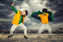 Two brothers dancing break dance.Hip-hop style.The cool kids.Children`s fashion. Children`s fashion.Two brothers dancing break dance.Hip-hop style.The cool kids stock photography