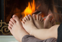 Children's feet are heated Stock Images